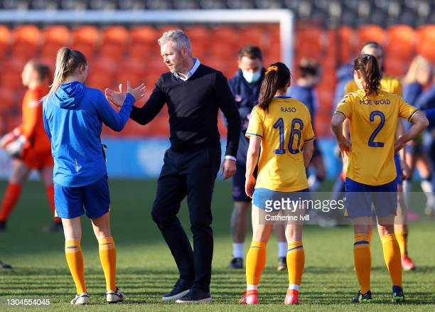 Willie Kirk, first team manager of Everton interacts with his players following the Barclays FA Women's Super League match between Tottenham Hotspur...