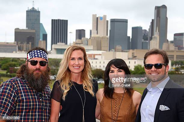 Willie Korie Robertson of the AE hit reality show Duck Dynasty pose with Marcus and Cassi Smith during the Texas Motor Speedway Media Day at Gilley's...