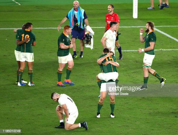 Willie Le Roux of South Africa and jumps on teammate Frans Steyn as they celebrate their team's victory at fulltime as Luke CowanDickie reacts...