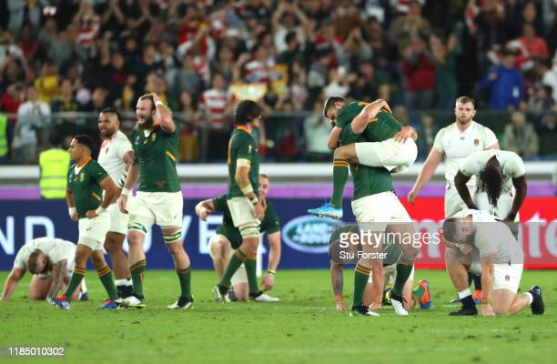 Willie Le Roux of South Africa and jumps on teammate Frans Steyn as they celebrate their team's victory at full-time as Luke Cowan-Dickie reacts...