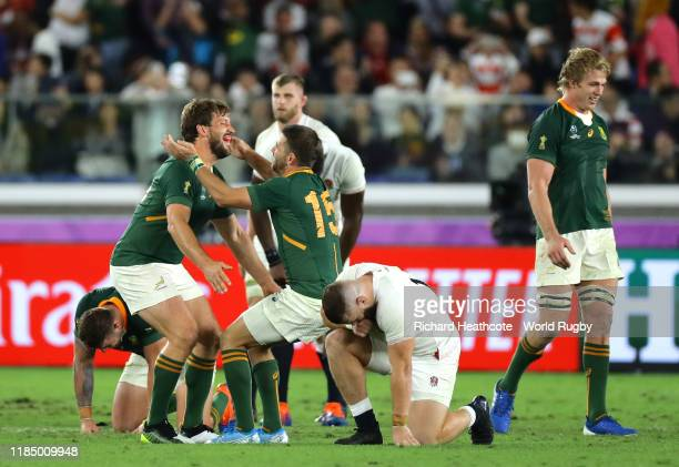 Willie Le Roux of South Africa and teammate Frans Steyn celebrate their team's victory at fulltime following the Rugby World Cup 2019 Final between...