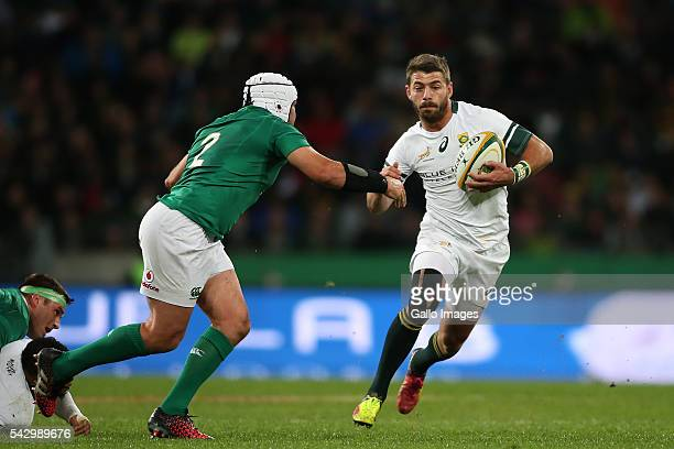 Willie le Roux of South Africa attempts to get past Ireland captain Rory Best during the 3rd Castle Lager Incoming Series Test match between South...