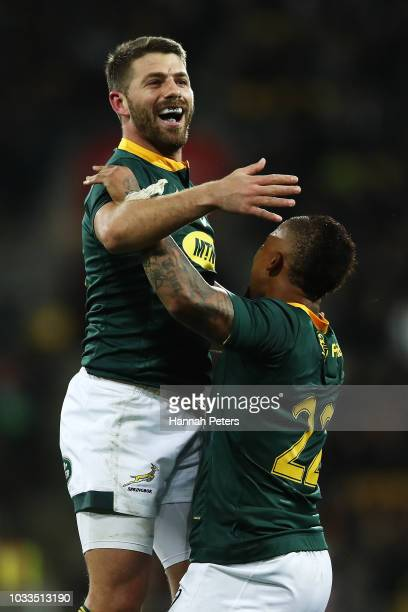 Willie le Roux of South Africa celebrates with Elton Jantjies after winning The Rugby Championship match between the New Zealand All Blacks and the...