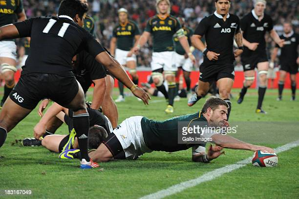 Willie le Roux of South Africa dives over for his try during The Rugby Championship match between South Africa and New Zealand at Ellis Park on...