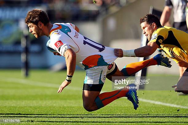 Willie le Roux of the Cheetahs is tackled by Cory Jane of the Hurricanes during the round six Super Rugby match between the Hurricanes and Cheetahs...