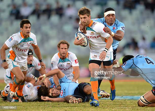 Willie le Roux of the Cheetahs is tackled by Wycliff Palu of the Waratahs during the Super Rugby match between Toyota Cheetahs and Waratahs from Free...