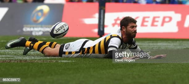 Willie le Roux of Wasps dives over the try line but drops the ball to cancel out a try during the European Rugby Champions Cup match between Leinster...