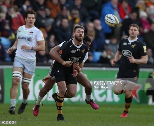 Willie le Roux of Wasps off loads the ball during the Aviva Premiership match between Wasps and Saracens at The Ricoh Arena on January 7 2018 in...