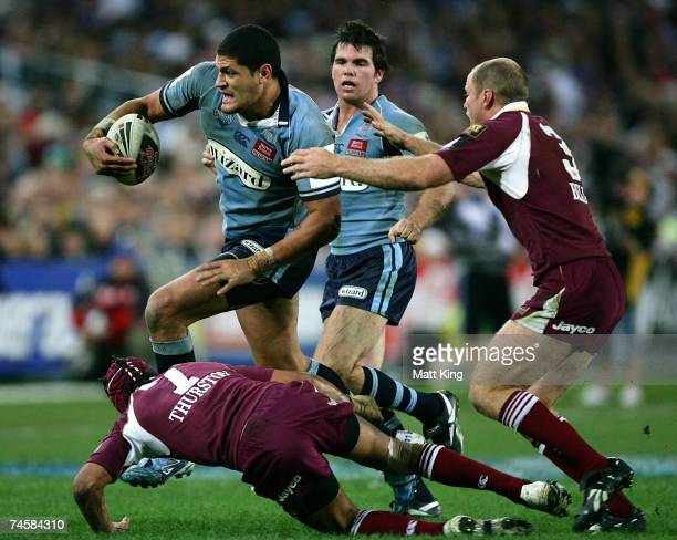 Willie Mason of the Blues takes on the Maroons defence during game two of the ARL State of Origin series between the New South Wales Blues and the...