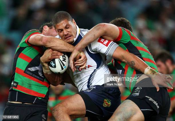 Willie Mason of the Cowboys is tackled during the round 13 NRL match between the South Sydney Rabbitohs and the North Queensland Cowboys at ANZ...