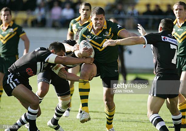 Willie Mason of the Kangaroos battles through the Kiwi defenders during the Centenary Test between the New Zealand Kiwi's and the Australian...