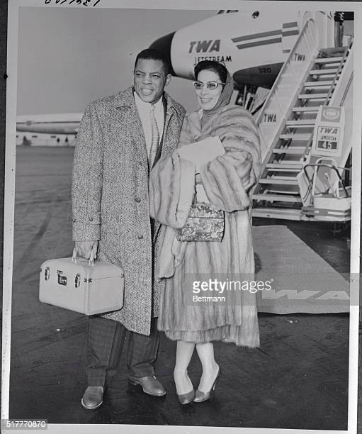 Willie Mays and his wife prepare to board a TWA jet stream flight to San Francisco here, where they will make their new home.
