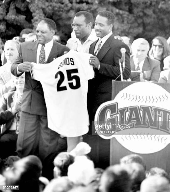 Willie Mays Bobby Bonds and Barry Bonds hold up the No 25 jersey that Barry Bonds will wear as a San Francisco Giant The three were welcomed at a San...