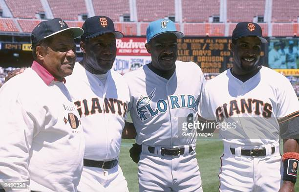 Willie Mays Bobby Bonds Andre Dawson and Barry Bonds pose during a game between the Florida Marlins and the San Francisco Giants at 3Com Park April...