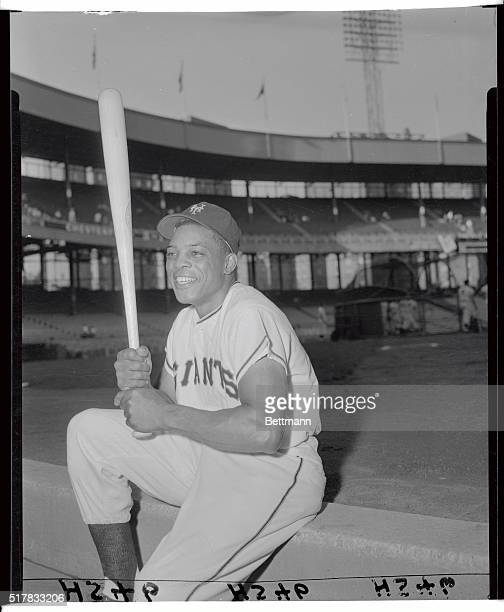 """Willie Mays is shown here at """"bat rack,"""" as he holds his favorite bat in hand."""
