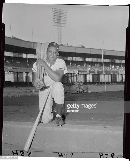 """Willie Mays is shown here at """"bat rack,"""" with group of bats and chosen favorite."""