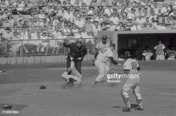 Willie Mays lands on his back here after colliding with Braves pitcher Tony Cloniger while trying to score from third base Mays eventually stood on...