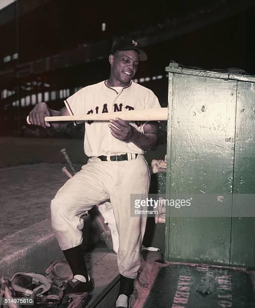 Willie Mays, N.Y. Giants sliding bat into bat rack. Color