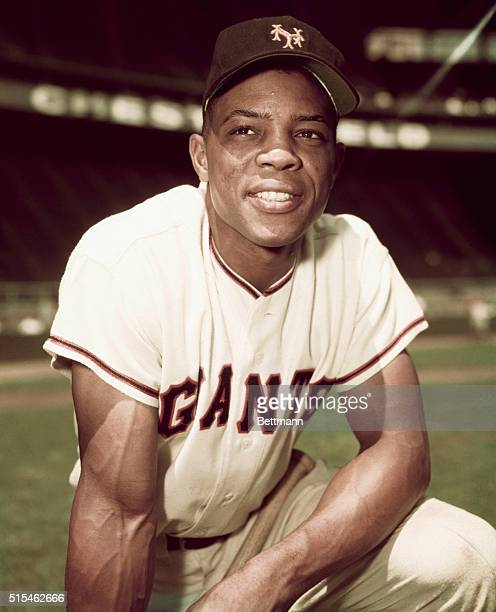 Willie Mays of the New York Giants is shown here in this threequarters length photo on one knee