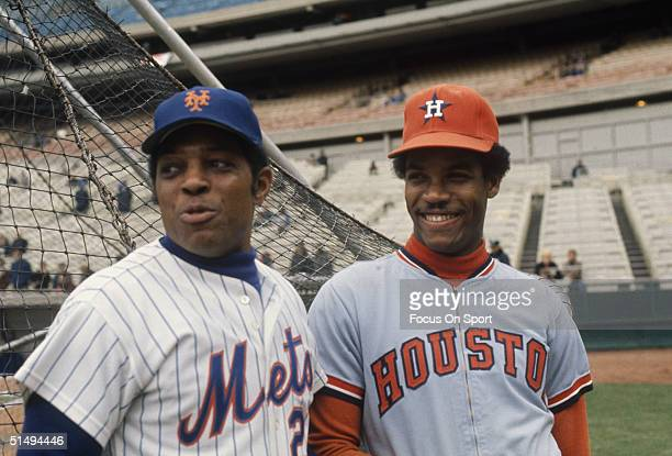 Willie Mays of the New York Mets and Cesar Cedeno of the Houston Astros talk during batting practice at Shea Stadium during the 1972 season in...