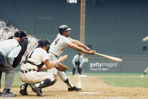 Willie Mays of the San Francisco Giants completes his swing and connects with the ball during the All Star Game at Robert F Kennedy Stadium in...