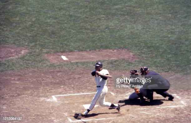 Willie Mays of the San Francisco Giants swings at the pitch as catcher Orlando McFarlane of the Pittsburgh Pirates and umpire Paul Pryor look on...