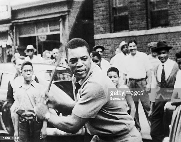 Willie Mays playing stick ball with Harlem kids