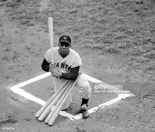 Willie Mays poses with bats symbolizing the fiftyone home runs he hoped to have by the end of the last day of the season He did it tying a club...