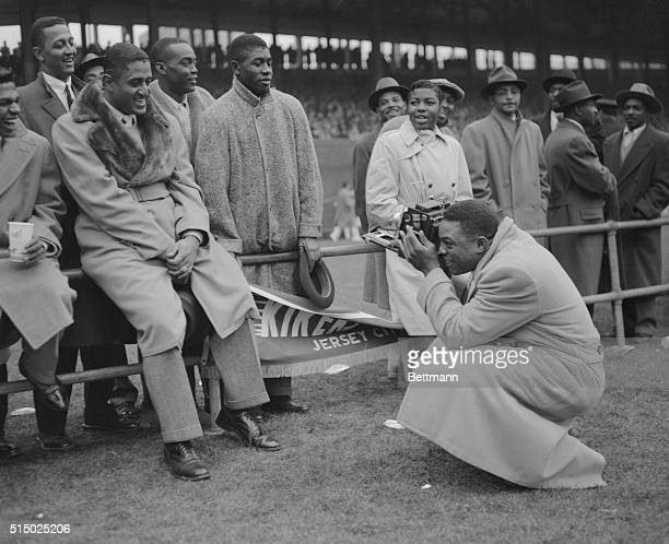 Willie Mays star outfielder for the New York Giants was playing the role of photographer today at the Polo Grounds when he lined up pitcher Don...