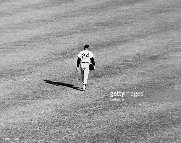 Willie Mays who cast a mighty shadow over center field for many years, makes the long slow solitary walk to the dressing room here on September 11th,...