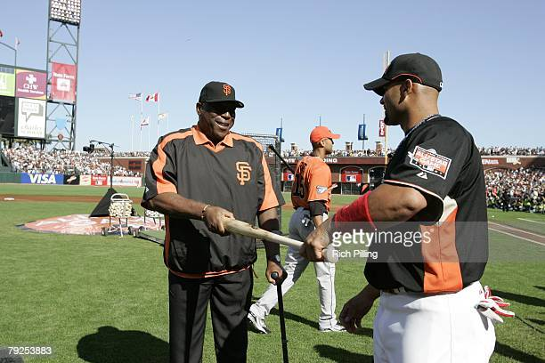 Willie McCovey touches bat of Albert Pujols of the St Louis Cardinals before the Home Run Derby at ATT Park in San Francisco California on July 9 2007