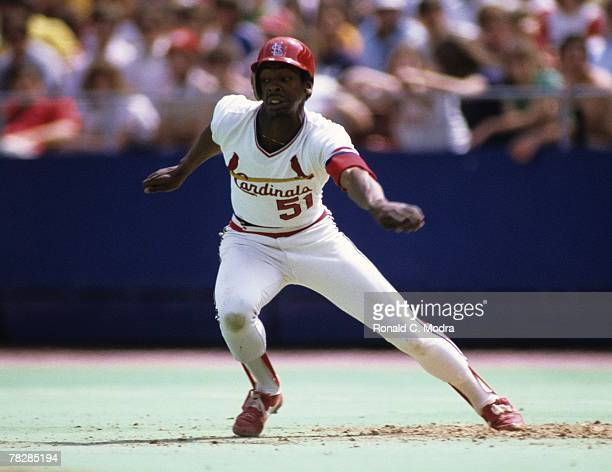 Willie McGee of the St Louis Cardinals leading off first base during a game in 1983 in St Louis Missouri