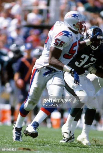 Willie McGinest of the New England Patriots in action against the Philadelphia Eagles during an NFL game circa 1996 at Foxboro Stadium in Foxborough...