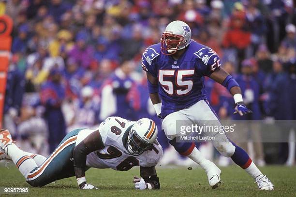 Willie McGinist of the New England Patriots gets past a blocker during a NFL football game against the Miami Dolphins on November 23 1997 at Gillette...