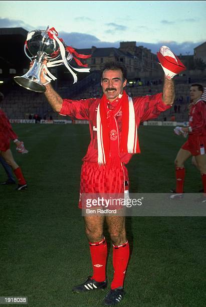 Willie Miller of Aberdeen proudly shows off the Skol Cup trophy after the final between Aberdeen and Rangers at Hampden Park in Glasgow Scotland...