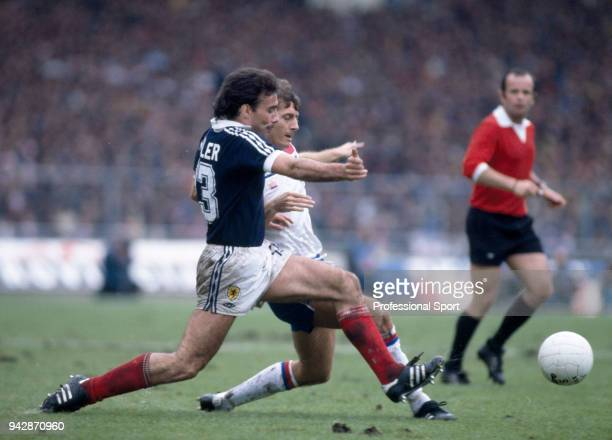 Willie Miller of Scotland and Trevor Francis of England battle for the ball during a British Home Championship match at Wembley Stadium on May 23...