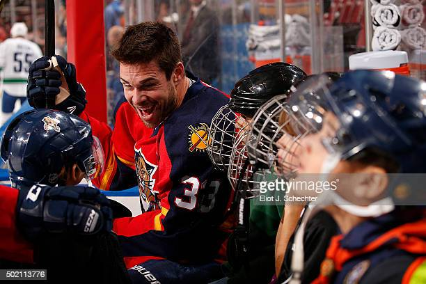 Willie Mitchell of the Florida Panthers jokes with a fan prior to the start of the game against the Vancouver Canucks at the BBT Center on December...