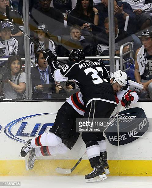 Willie Mitchell of the Los Angeles Kings checks Ilya Kovalchuk of the New Jersey Devils in Game Four of the 2012 Stanley Cup Final at Staples Center...