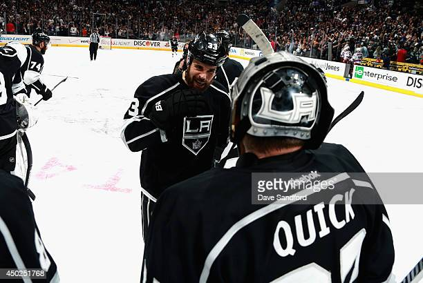Willie Mitchell of the Los Angeles Kings congratulates goaltender Jonathan Quick after the Kings defeated the New York Rangers 54 with an overtime...
