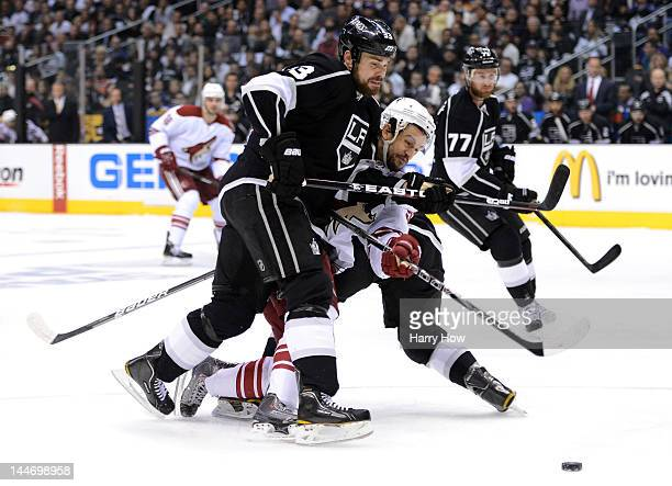 Willie Mitchell of the Los Angeles Kings defends Antoine Vermette of the Phoenix Coyotes in the first period in Game Three of the Western Conference...