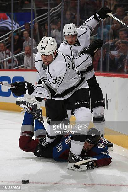 Willie Mitchell of the Los Angeles Kings pursues the puck as Patrick Bordeleau of the Colorado Avalanche hits the ice during their preseason game at...