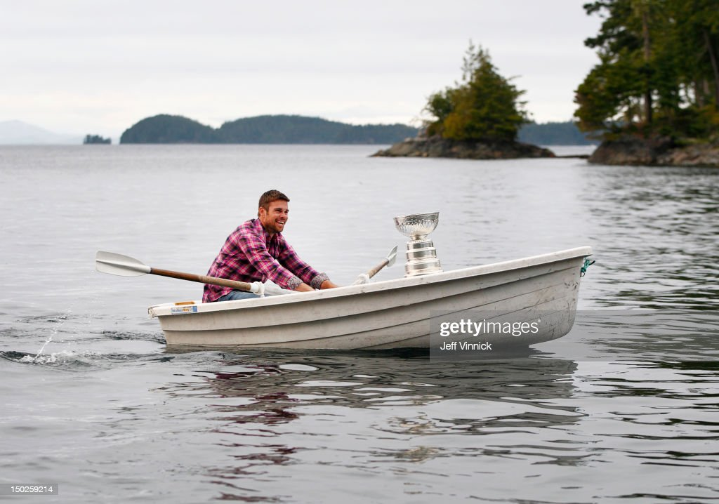 Willie Mitchell #33 of the Los Angeles Kings sits with the Stanley Cup as he paddles a rowboat August 12, 2012 in Telegraph Cove, British Columbia, Canada. Mitchell took the Stanley Cup to his hometown of Port McNeill, B.C. for his one-day celebration with the prized trophy.