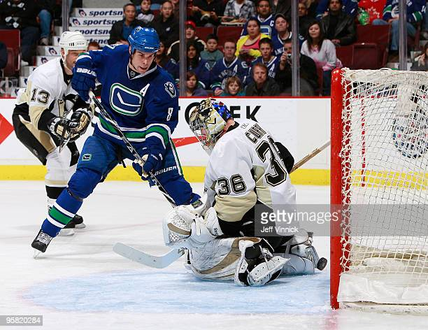 Willie Mitchell of the Vancouver Canucks scores on a backhand in close past John Curry of the Pittsburgh Penguins during their game at General Motors...