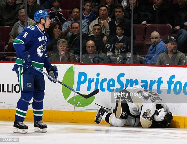 Willie Mitchell of the Vancouver Canucks yells at the referee as Sidney Crosby of the Pittsburgh Penguins lays injured on the ice after being high...
