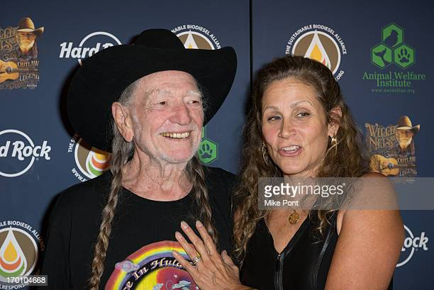 Willie Nelson and Annie D'Angelo attend Hard Rock International's Wille Nelson Artist Spotlight Benefit Concer at Hard Rock Cafe Times Square on June...