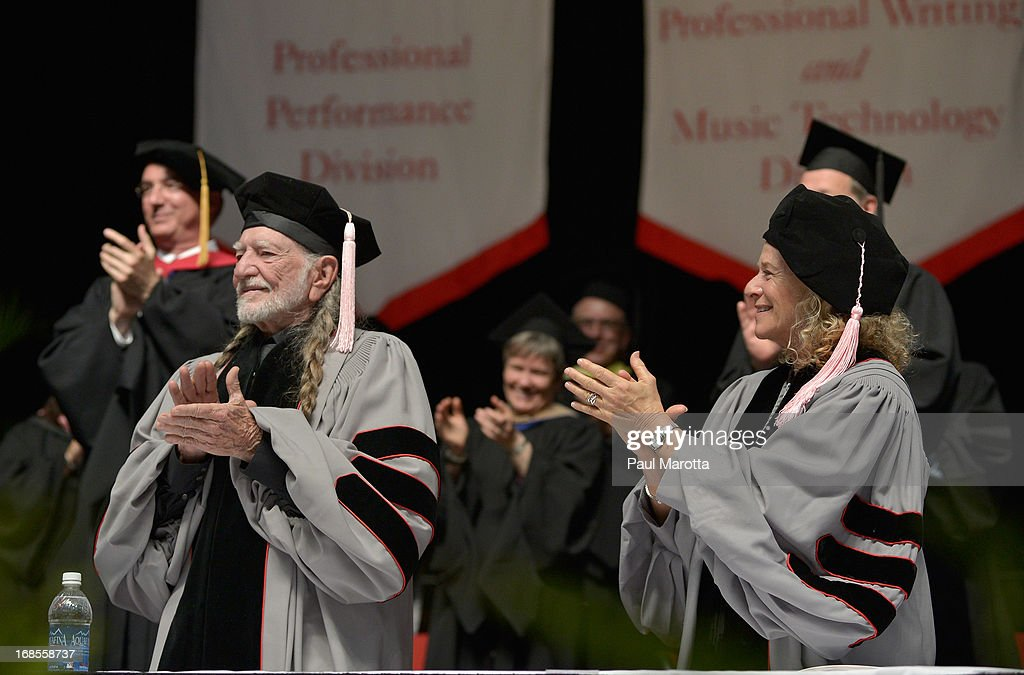 Willie Nelson (L) and Carole King receive Honorary Doctor of Music Degrees during the 2013 Berklee College Of Music Commencement Ceremony at Berklee College of Music on May 11, 2013 in Boston, Massachusetts.