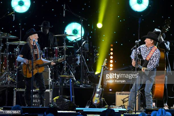 Willie Nelson and George Strait perform onstage for Willie Life and Songs of an American Outlaw at Bridgestone Arena on January 12 2019 in Nashville...