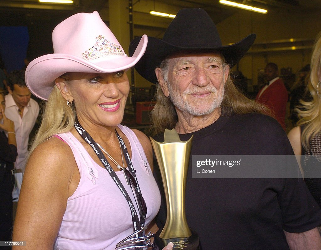 Willie Nelson (right) and guest during 39th Annual Academy of Country Music Awards - Backstage and Audience at Mandalay Bay Resort and Casino in Las Vegas, Nevada, United States.
