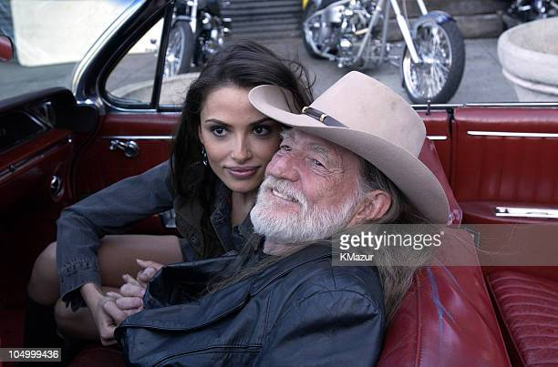 Willie Nelson and Model Almudena Fernandez during Willie Nelson on the Set of His Video for the Song 'Maria/ShutUp and Kiss Me' at Red Rock West...