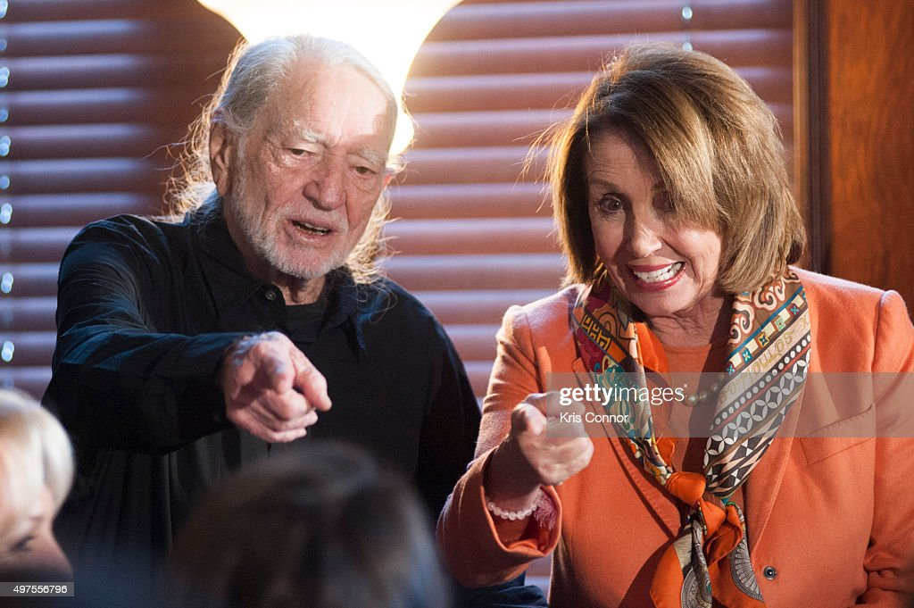 Willie Nelson and Rep. Nancy Pelosi (D-CA) attend the 2015 Gershwin Prize Luncheon Honoring Willie Nelson in the Thomas Jefferson Building of the Library of Congress on November 17, 2015 in Washington, DC.